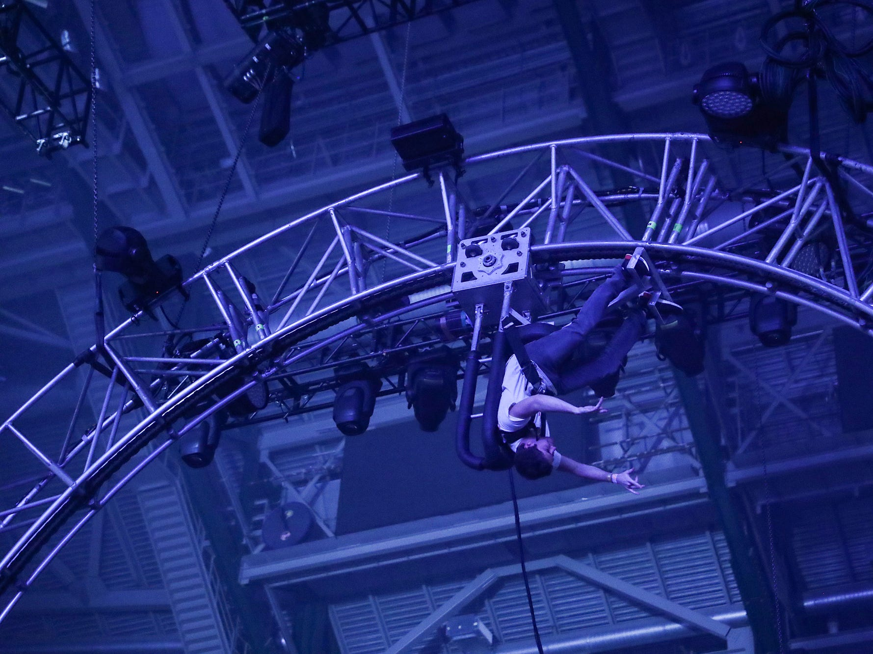 A fans rides a slow-moving circular roller coaster while Travis Scott performs on his Astroworld Tour at Banker's Life Fieldhouse in Indianapolis on Wednesday, Feb. 20, 2018.