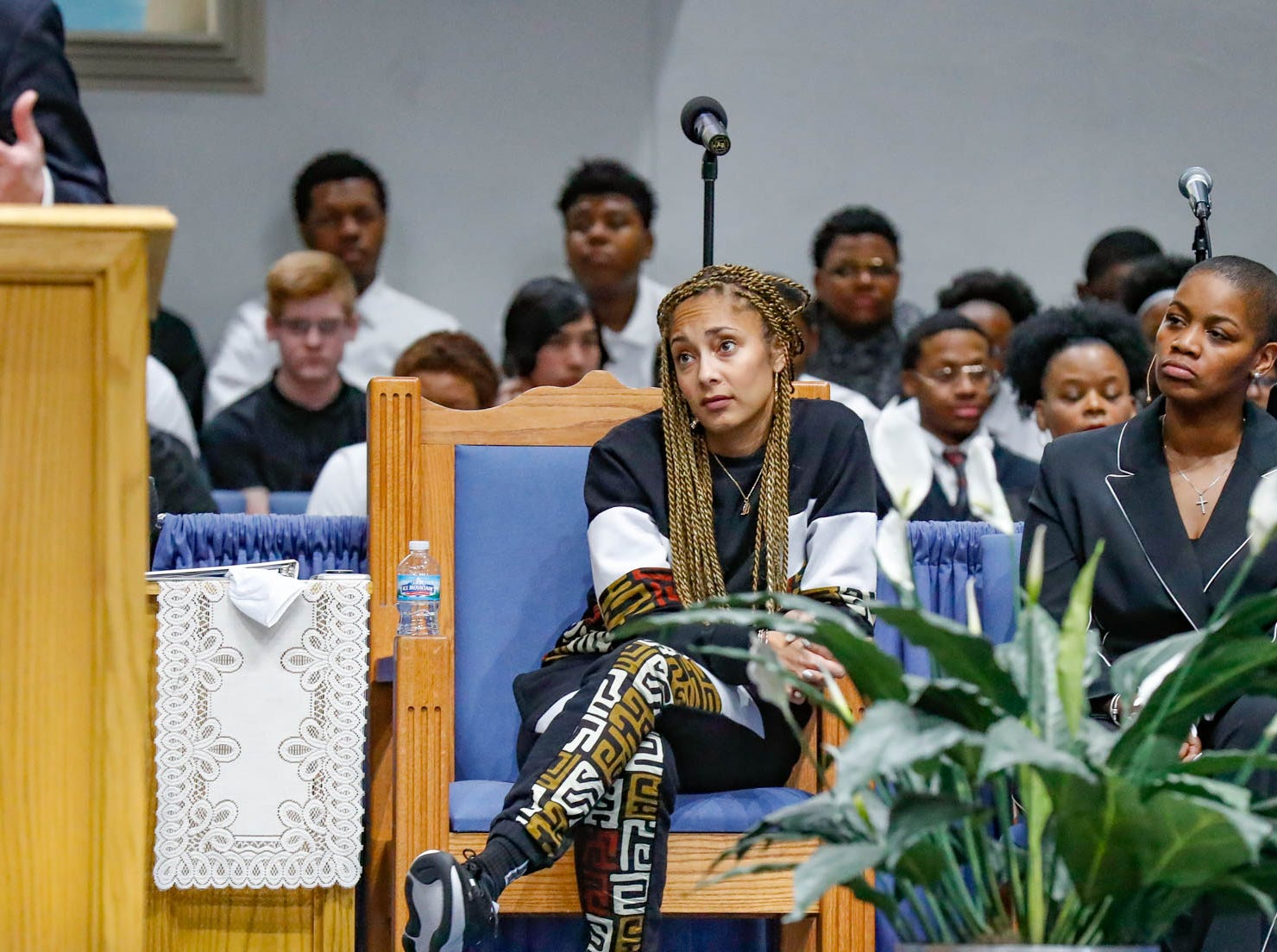 """American comedian, actress, disc jockey (DJ), recording artist and radio personality, Amanda Seales, seated right, listens to Indianapolis Mayor Joe Hogsett speak during the annual Steward Speakers Lecture Series event, held at Olivet Missionary Baptist Church in Indianapolis on Thursday, Feb. 21, 2019. This years theme was """"Year of the woman""""."""