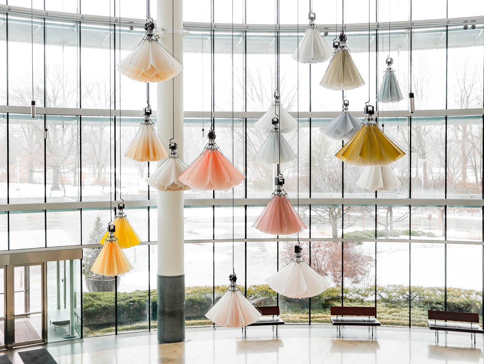 "Paper flowers open and close in the kinetic sculptural installation titled ""Meadow,"" from the 