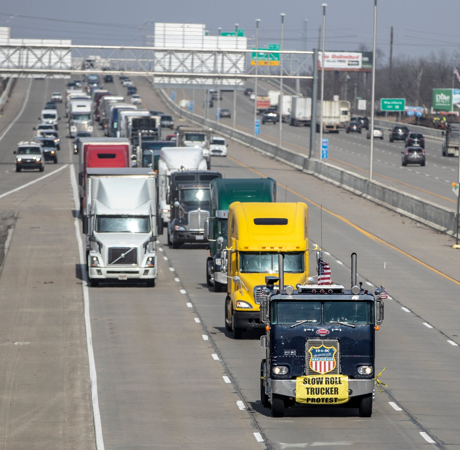 Truck drivers make two 45 mph loops around I-465 in slow-roll protest