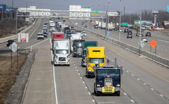 The front of a slow roll protest that picked up dozens of truckers who drove 45mph on 465, Indianapolis, Thursday, Feb. 21, 2019. They are drawing attention to what they consider to be unfair federal expectations about the logging of their hours electronically.