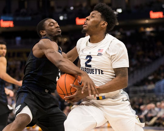 Feb 20, 2019; Milwaukee, WI, USA; Butler Bulldogs guard Kamar Baldwin (3) defends Marquette Golden Eagles guard Sacar Anim (2) during the first half at Fiserv Forum.