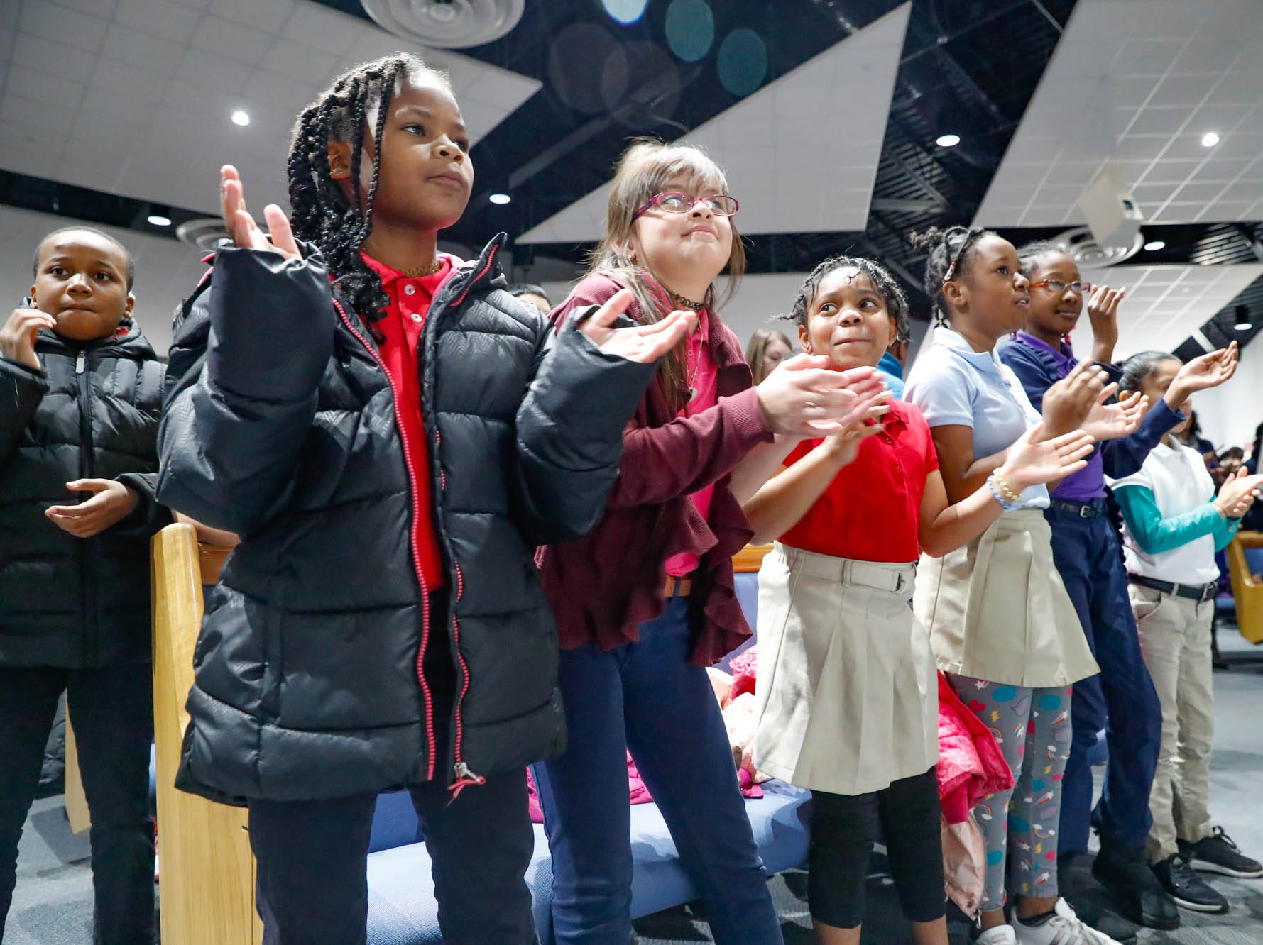 """School children sing and dance to the Tri-City School Gosphel Choir during the annual Steward Speakers Lecture Series event, held at Olivet Missionary Baptist Church in Indianapolis on Thursday, Feb. 21, 2019. This years theme was """"Year of the woman""""."""