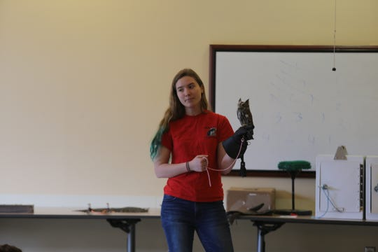 Claire Jones, a 19-year-old sophomore majoring in biology at Cornell University, shows Odin, an owl injured in a car accident.