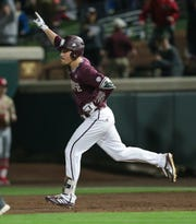 Mississippi State's Elijah MacNamee  celebrates after hitting a home run. Mississippi State opened the 2019 baseball season against Youngstown State on Friday, February 15, 2019. Photo by Keith Warren