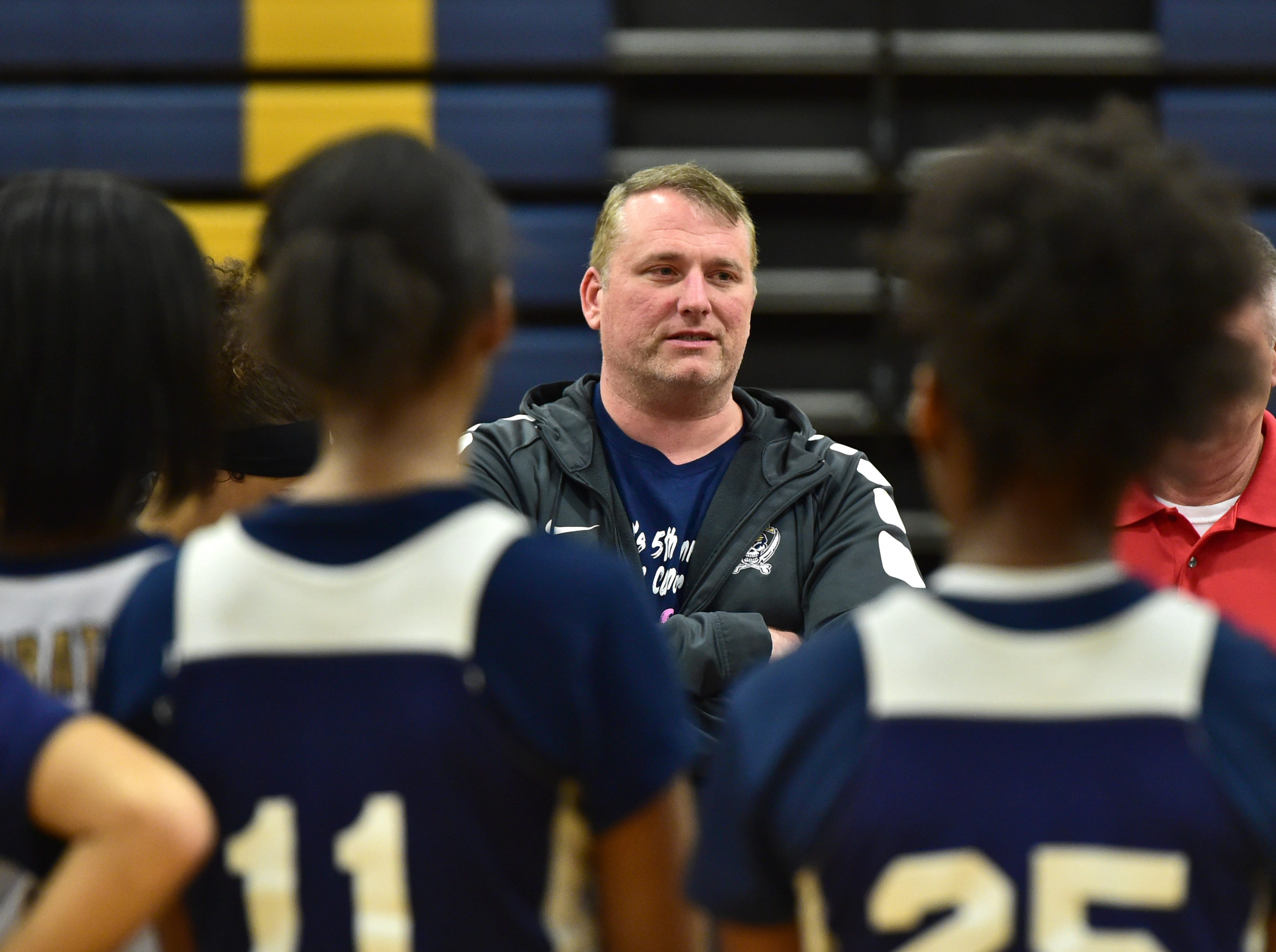 Pearl High School acting girls basketball head coach Jason Kennedy coaches his varsity team while Kennedy's wife and head coach Lacey Kennedy is deployed overseas with the Army reserve. Thursday, Feb. 21, 2019.