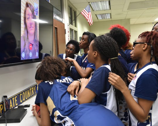 Pearl High School ladies basketball coach Lacey Kennedy talks to her team via FaceTime video from Qatar where she is currently deployed with the U.S. Army reserve. Thursday, Feb. 21, 2019 in Pearl, Miss.