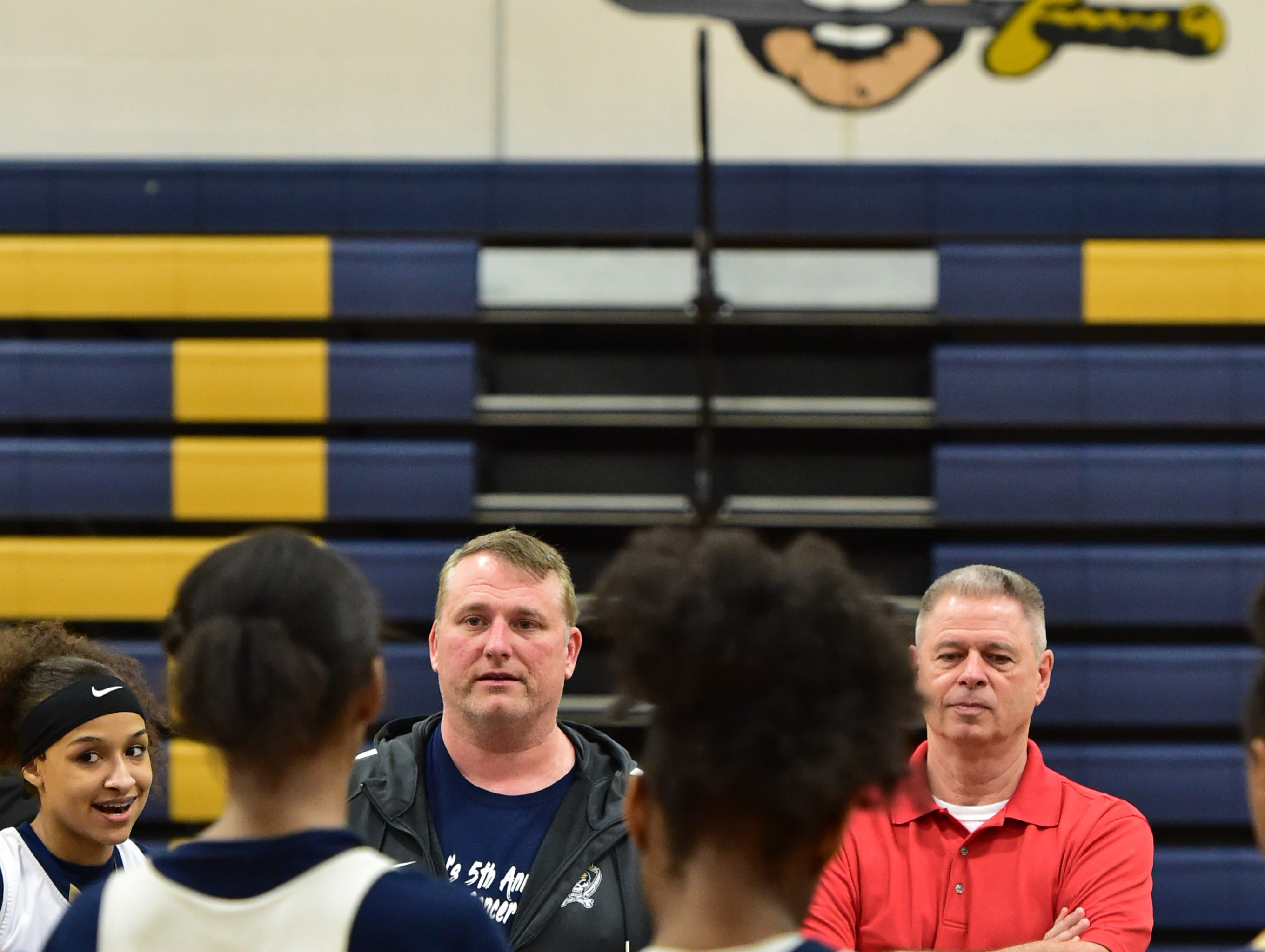Pearl High School girls basketball acting head coach Jason Kennedy (center) and acting assistant coach Wayne Fortenberry (right)  coach the Pearl team while Kennedy's wife and head coach Lacey Kennedy is deployed overseas with the Army reserve. Thursday, Feb. 21, 2019 in Pearl, Miss.