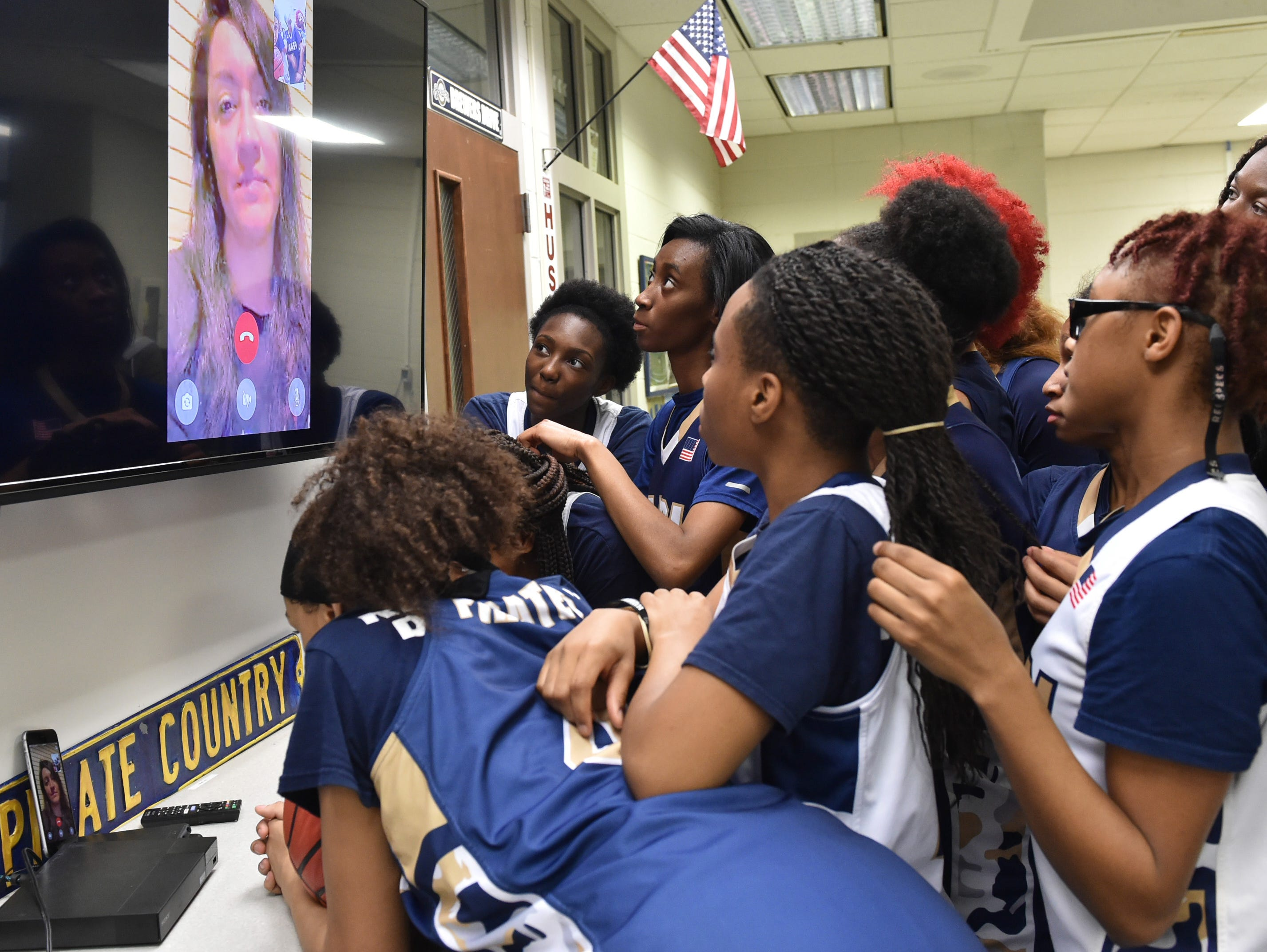 Pearl High School ladies basketball head coach Lacey Kennedy talks to her team via FaceTime video from Qatar where she is currently deployed with the U.S. Army reserve. Kennedy's husband, Jason Kennedy, has taken on the role of head coach while Mrs. Kennedy is away. Mr. Kennedy serves as assistant coach for the team when both Kennedys are home. Thursday, Feb. 21, 2019 in Pearl, Miss.