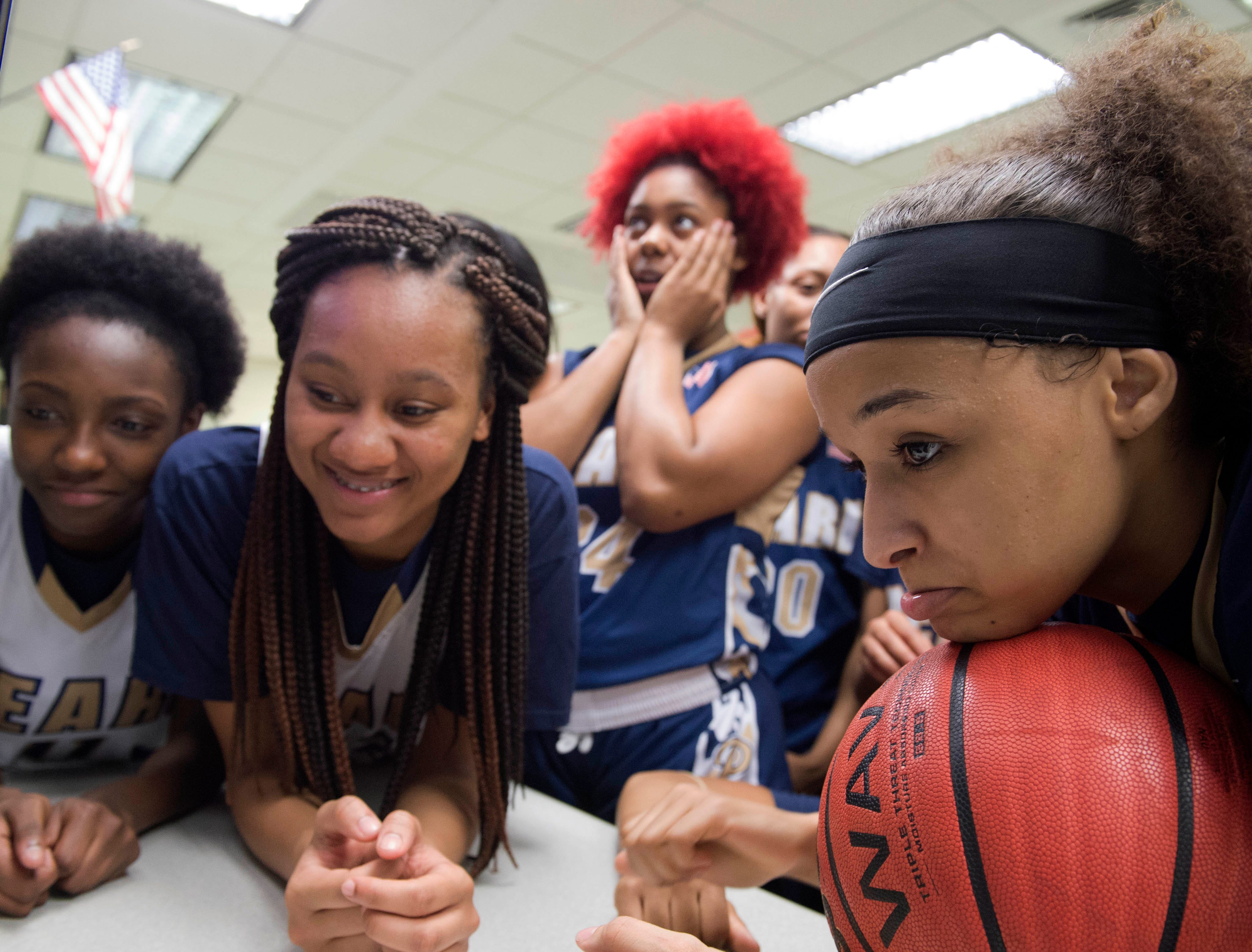 Pearl High School girls varsity basketball players talk with coach Lacey Kennedy via FaceTime video. Coach Kennedy is currently deployed with the U.S. Army reserve in the middle east. Kennedy's husband, Jason Kennedy, has taken on the role of head coach while Mrs. Kennedy is away. Mr. Kennedy serves as assistant coach for the team when both are home. Thursday, Feb. 21, 2019 in Pearl, Miss.