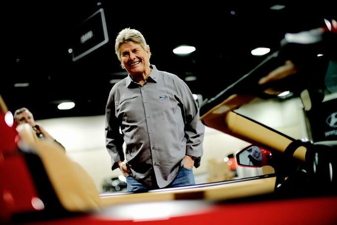 Rod Milligan, president of ET Motorgear, stands with his Ferrari which will be on display at the Knox News Auto Show in the Knoxville Convention Center in Knoxville, Tennessee on Wednesday, February 20, 2019.