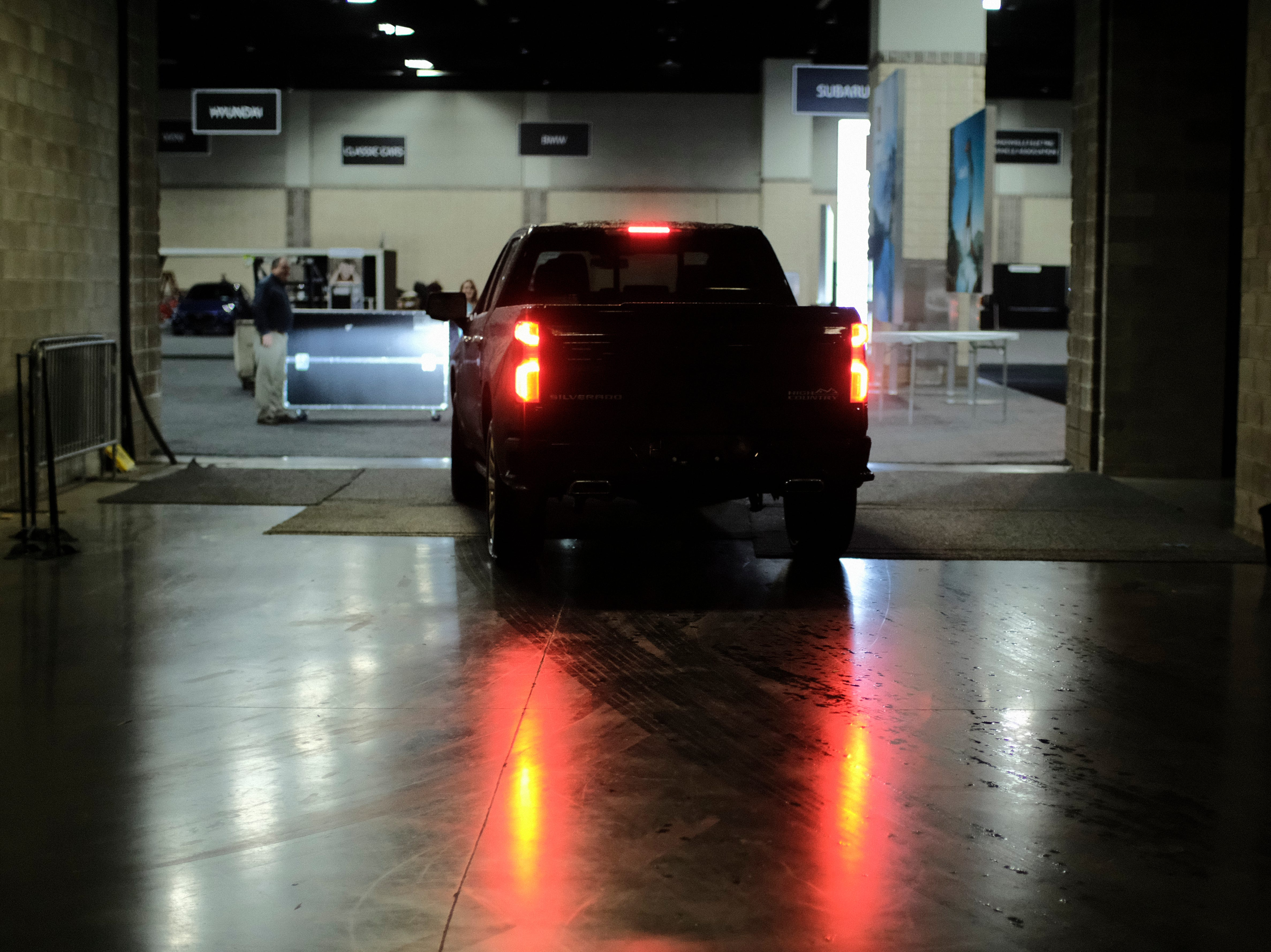 A Chevrolet Silverado High Country edition pickup truck enters the showroom at the Knox News Auto Show in the Knoxville Convention Center in Knoxville, Tennessee on Wednesday, February 20, 2019.