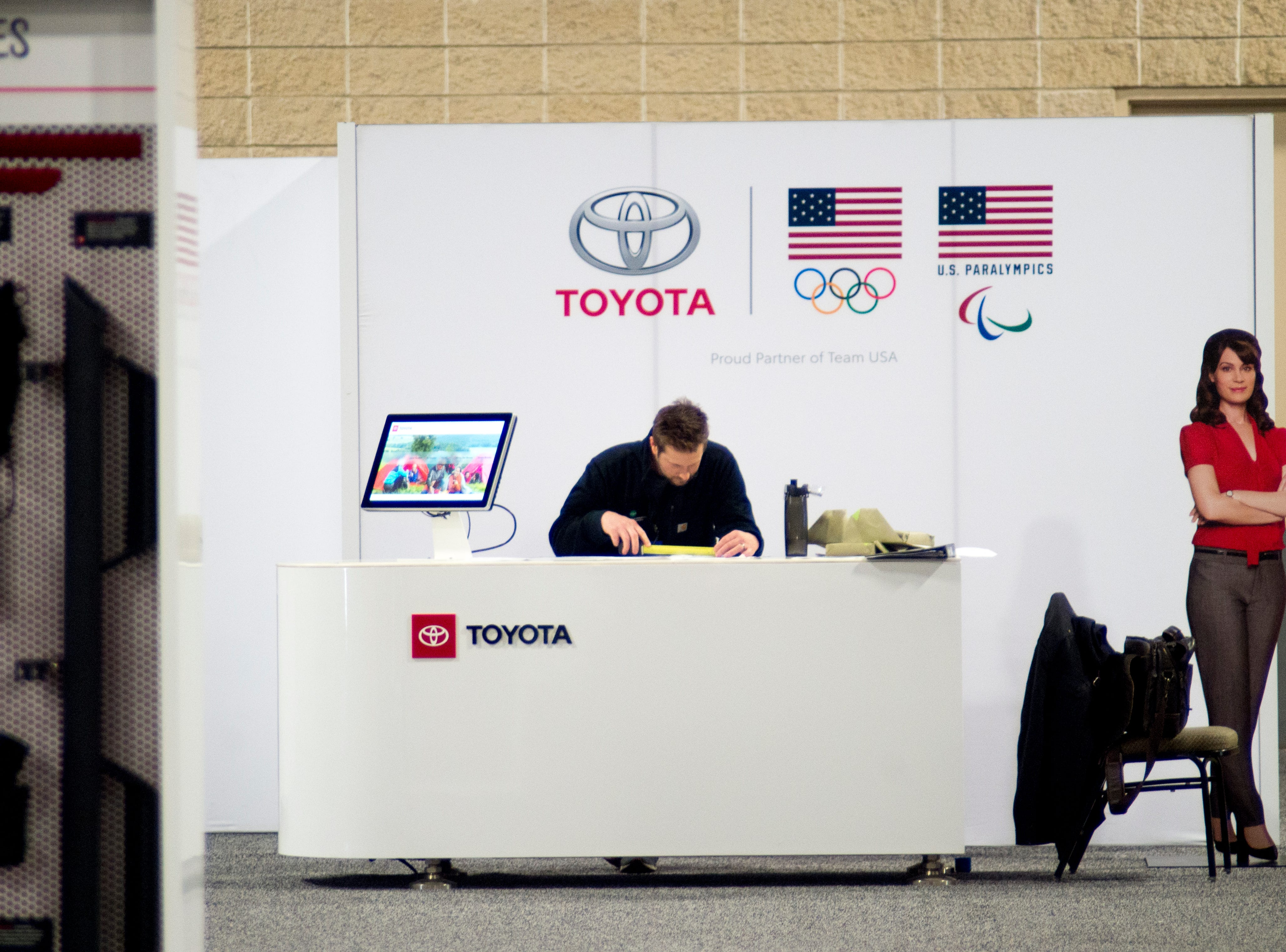 A worker looks at a floor plan for the Toyota booth at the Knox News Auto Show in the Knoxville Convention Center in Knoxville, Tennessee on Wednesday, February 20, 2019.