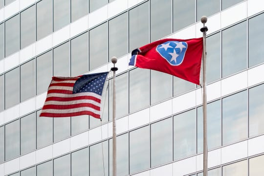 Photo of an office building in downtown Knoxville, Tennessee  with the US and Tennessee flags on poles.