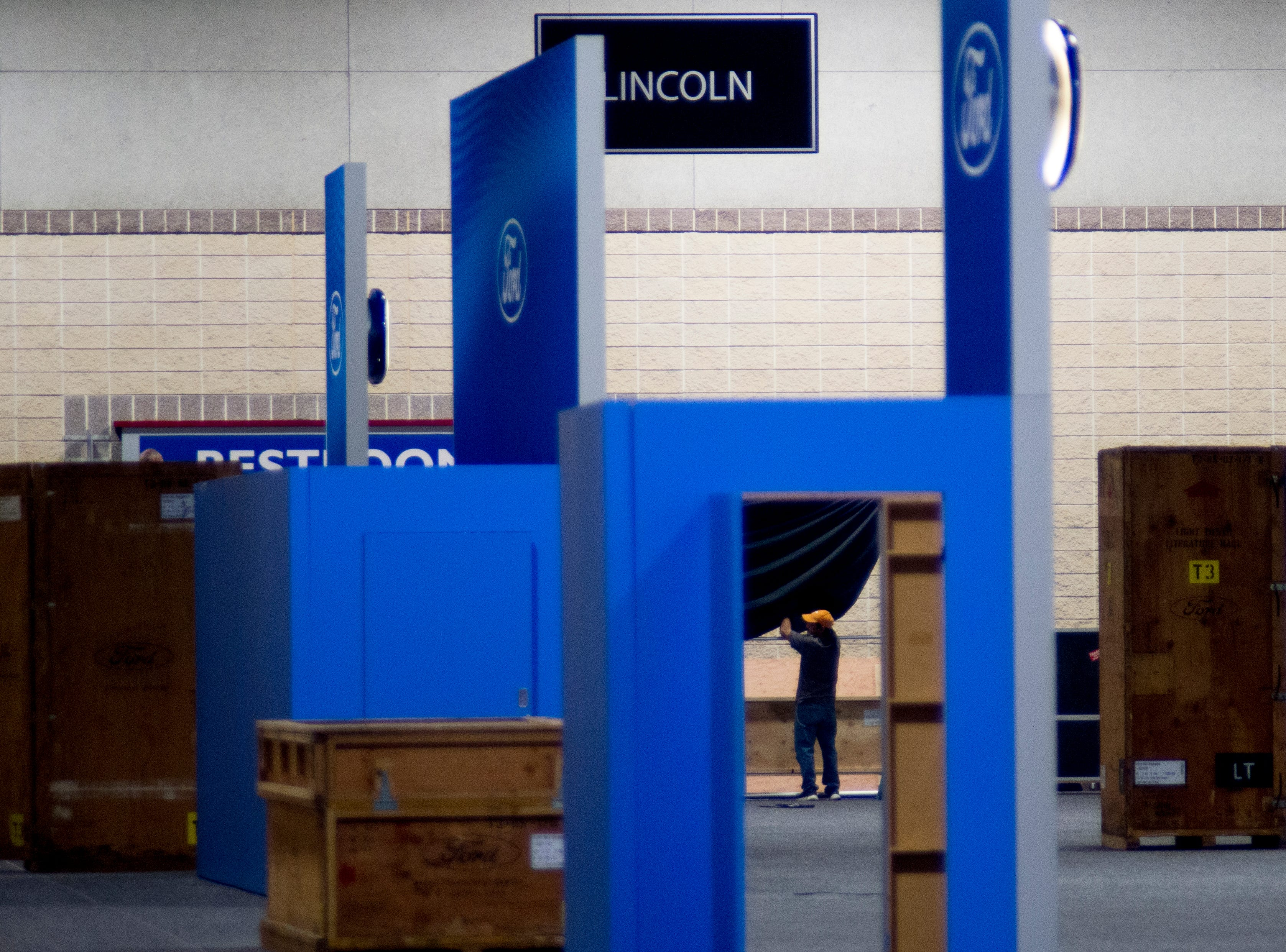 Workers set up a booth at the Knox News Auto Show in the Knoxville Convention Center in Knoxville, Tennessee on Wednesday, February 20, 2019.