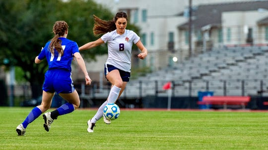 Teurlings Catholic's Kaitlyn Poirrier drives the ball down the field as the Rebels shut out Vandebilt in the Division III LHSAA girls soccer championship game Wednesday.
