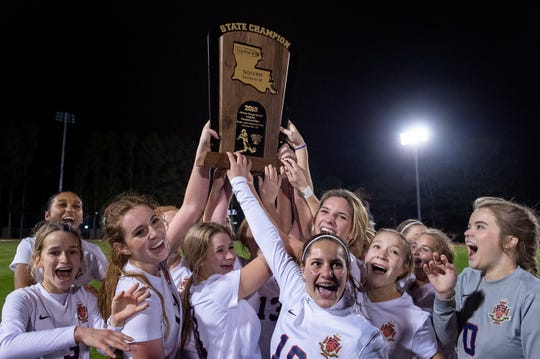 The Teurlings Catholic Rebels hoist their trophy into the air after winning the LHSAA Division III girls soccer championship over Vanderbilt Catholic on Wednesday, Feb, 20, 2019.