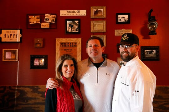 Jody, left, and Jeff, center, Dupler own The Village Food and Spirits in Amanda. Doug Manfrin is the restaurant's executive chef. The establishment's grand opening was Feb. 22.