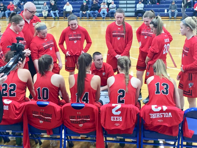 Fairfield Union coach Travis Shaeffer talks with his team during a timeout Wednesday in a Southeast District Semifinal against Circleville. The Falcons fell short, 43-40.