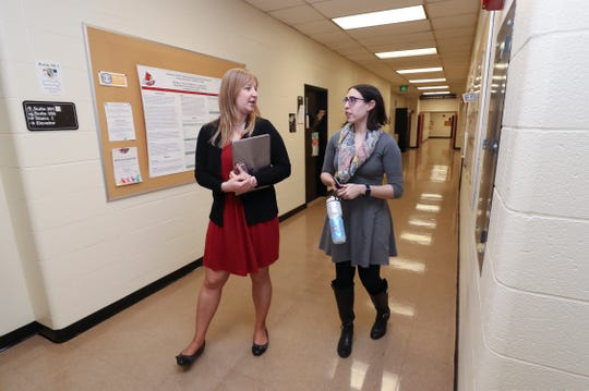 Irina Vanzhula, left, and Leigh Brosof walk to an eating disorder clinic at the University of Louisville.  They are both clinical psychology doctoral students who have been studying and treating eating disorders in the Eating Anxiety Treatment (EAT) lab at U of L.   Feb. 21, 2019