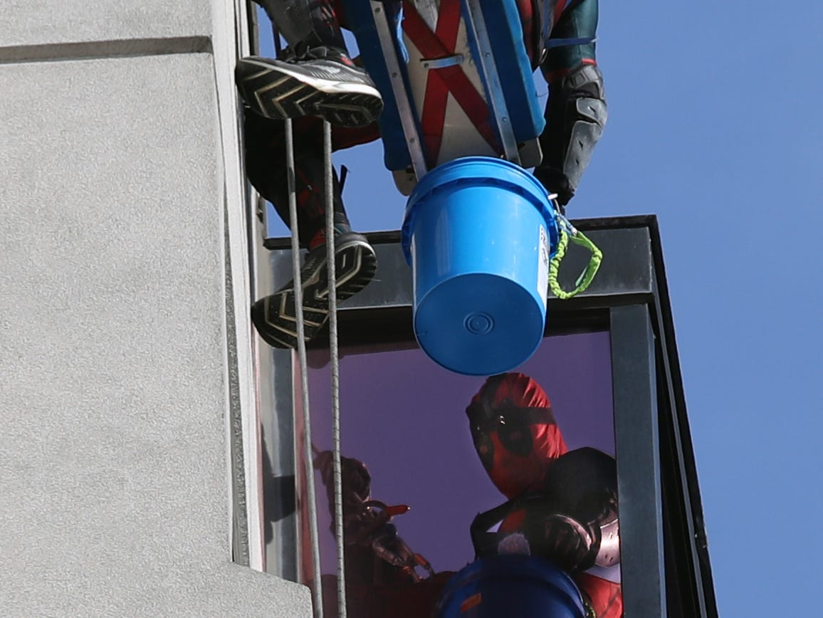 Pro Clean International cleans the windows at Norton Children's Hospital on Thursday morning dressed as Superheroes.  Johnny Haist is dressed up as Deadpool.  Feb. 21, 2019