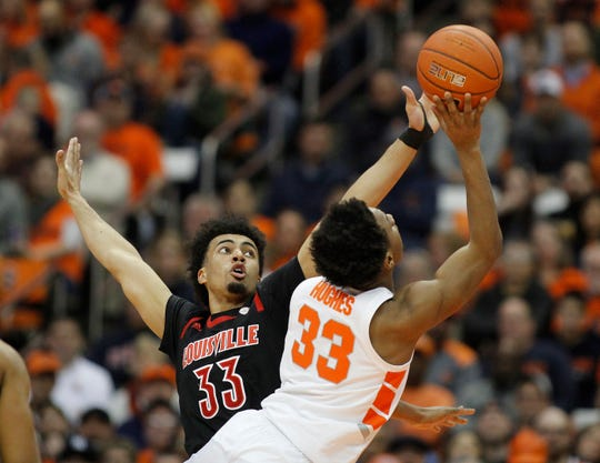 Louisville's Jordan Nwora, left, defends Syracuse's Elijah Hughes, right, during the first half of an NCAA college basketball game in Syracuse, N.Y., Wednesday, Feb. 20, 2019.