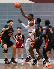 Waggener's Cobie Montgomery (0) looked to pass while being defended by Seneca during their game at Atherton High School.  Feb. 20, 2019