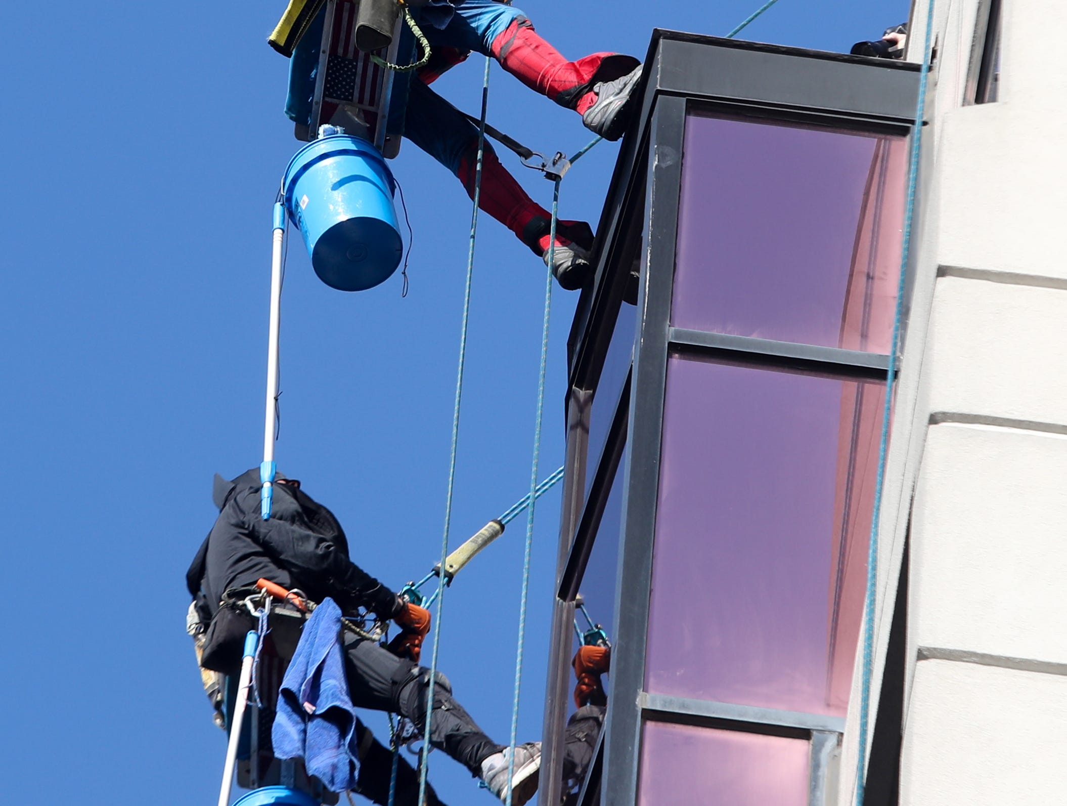 Pro Clean International cleans the windows at Norton Children's Hospital on Thursday morning dressed as Superheroes.  Lonnie Hart is dressed up as Spider-Man and William Hart is dressed up as Batman.  Feb. 21, 2019