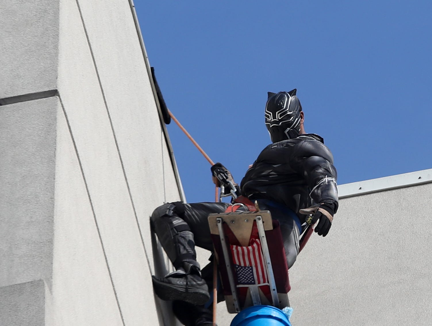 Pro Clean International cleans the windows at Norton Children's Hospital on Thursday morning dressed as Superheroes.  Lionel Bass is dressed up as the Black Panther.  Feb. 21, 2019