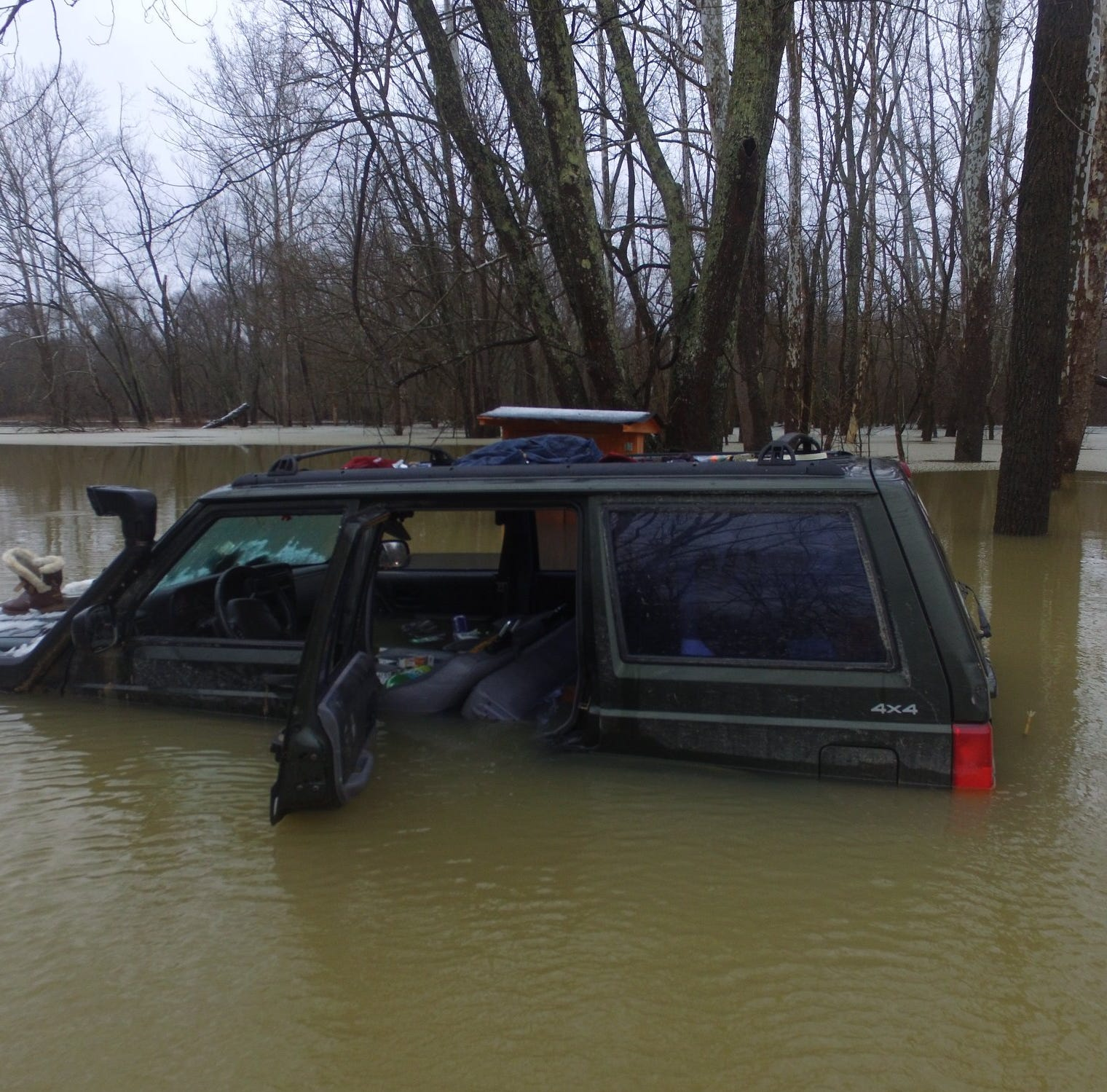 They spent the night stranded atop a Jeep after getting stranded in a flood