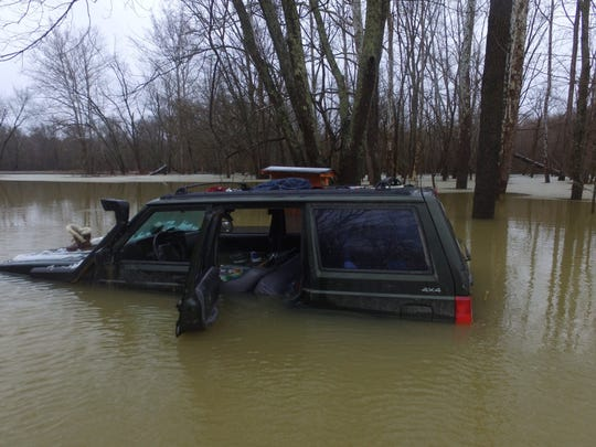 Four people were stranded for about 14 hours on top of their Jeep that got stuck in floodwaters near Maumee in Jackson County, Indiana.