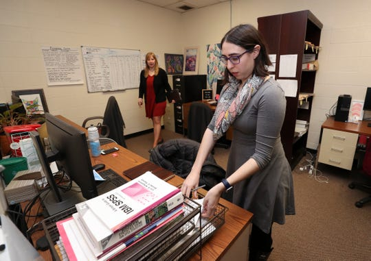 Leigh Brosof, right, and Irina Vanzhula prepare for an upcoming statistics presentation in the office for an eating disorder clinic at the University of Louisville.  They are both clinical psychology doctoral students who have been studying and treating eating disorders in the Eating Anxiety Treatment (EAT) lab at U of L.   Feb. 21, 2019