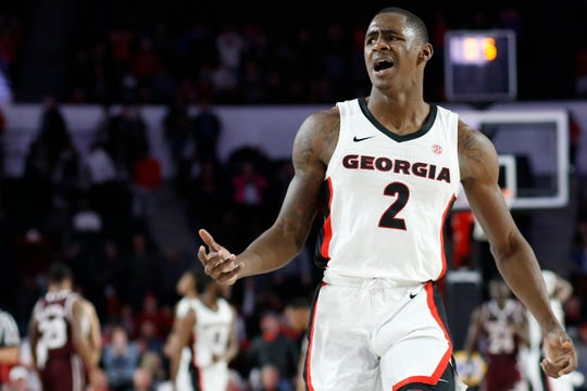 Georgia guard Jordan Harris reacts after a Georgia player was called for a foul with the game tied with half a second on the clock during an NCAA college basketball game against Mississippi State in Athens, Ga., Wednesday, Feb. 20, 2019. Georgia was called for a technical foul after a fan threw an item onto the court. (Joshua L. Jones/Athens Banner-Herald via AP)