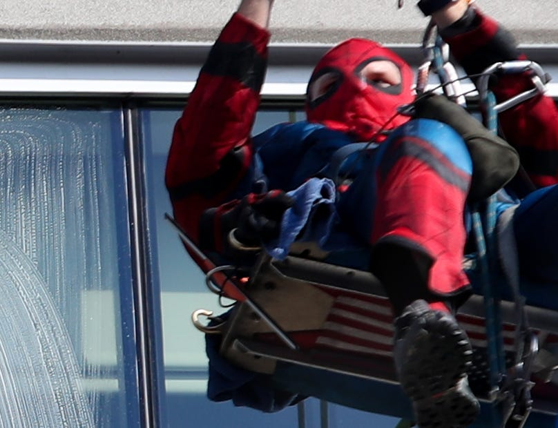 Pro Clean International cleans the windows at Norton Children's Hospital on Thursday morning dressed as Superheroes.  Lonnie Hart is dressed up as Spider-Man.  Feb. 21, 2019
