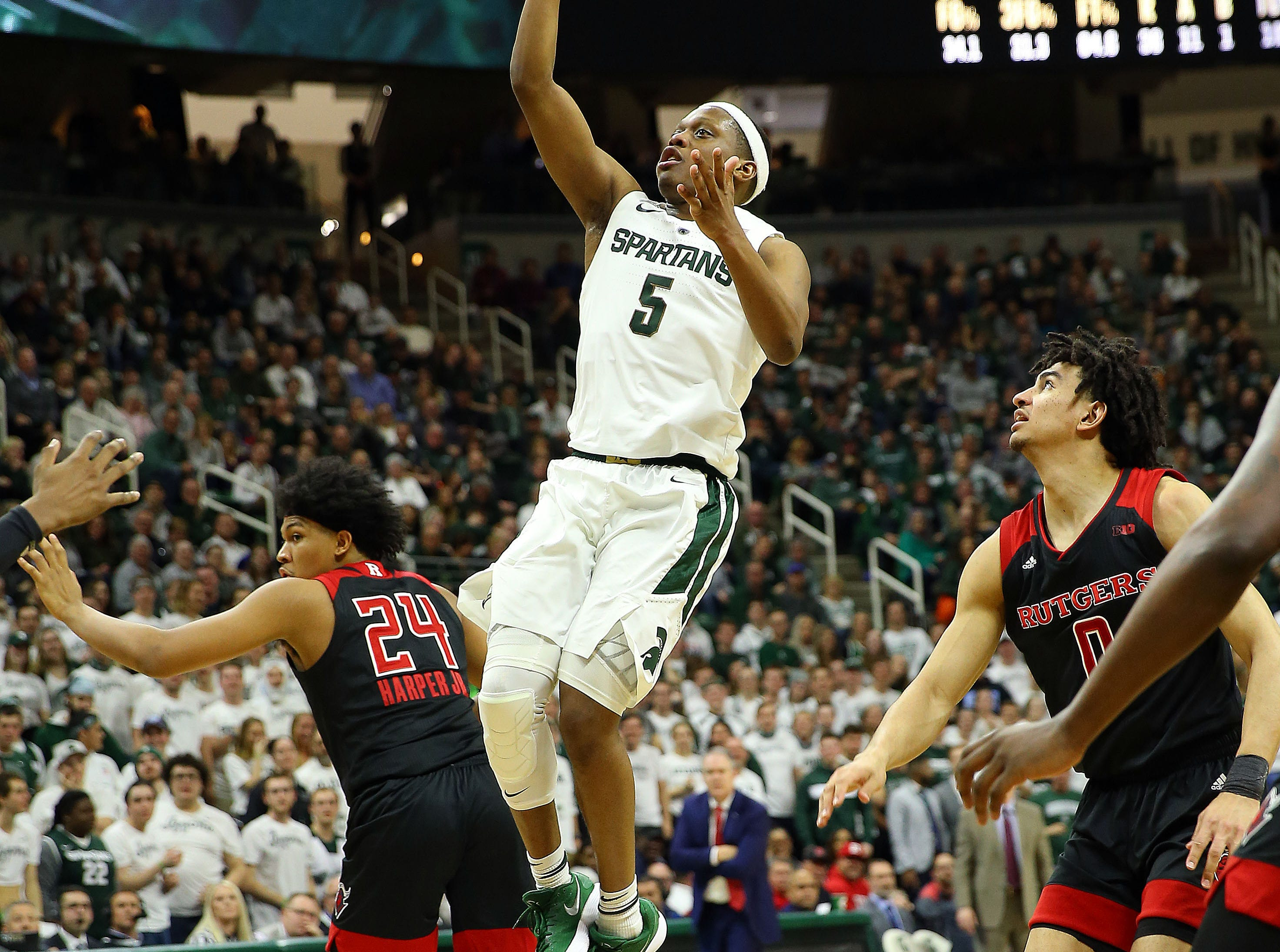 Feb 20, 2019; East Lansing, MI, USA; Michigan State Spartans guard Cassius Winston (5) drives to the basket during the second half of a game against the Rutgers Scarlet Knights at the Breslin Center. Mandatory Credit: Mike Carter-USA TODAY Sports