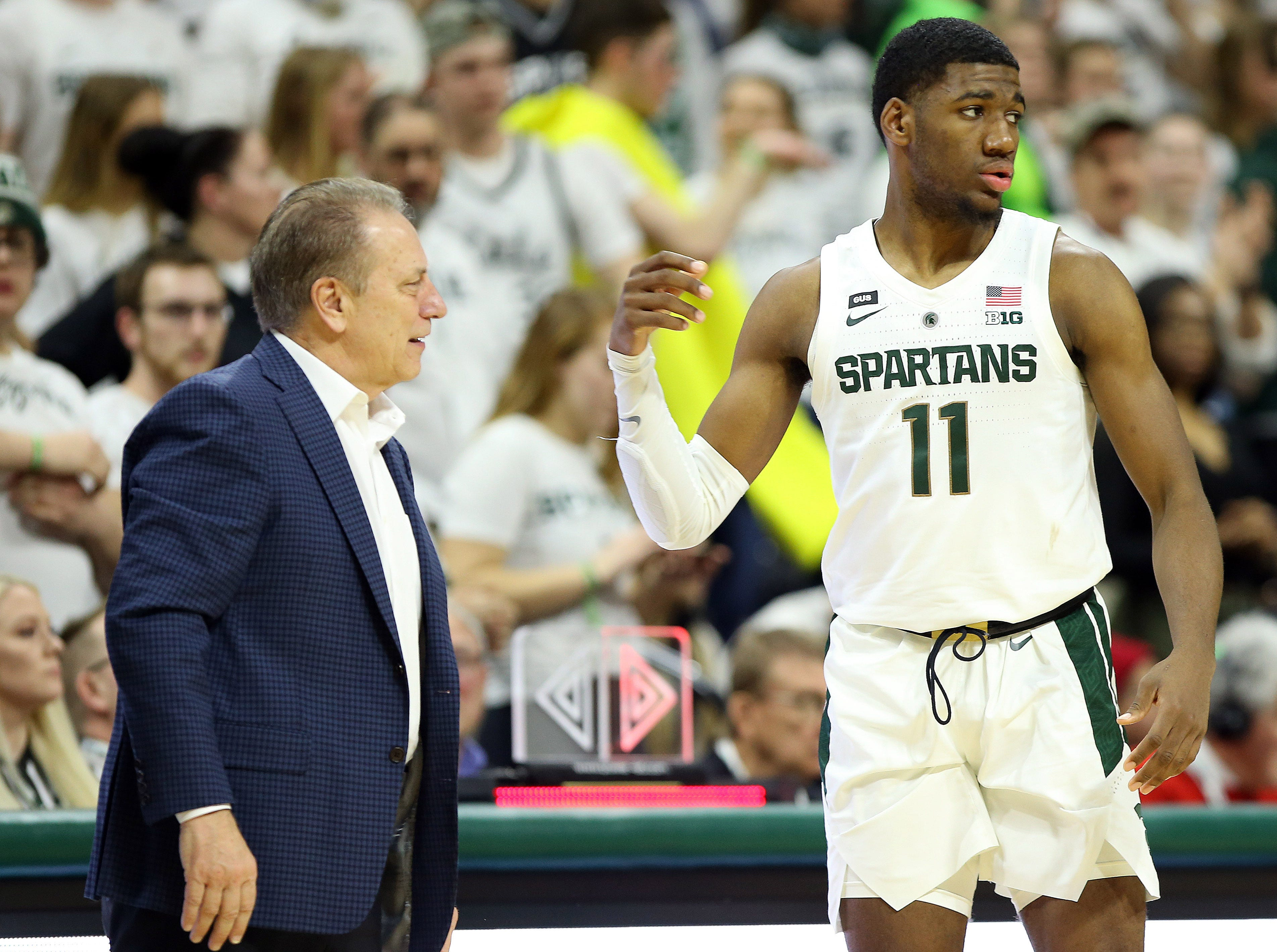 Feb 20, 2019; East Lansing, MI, USA; Michigan State Spartans head coach Tom Izzo talks to Michigan State Spartans forward Aaron Henry (11) during the second half of a game against the Rutgers Scarlet Knights at the Breslin Center. Mandatory Credit: Mike Carter-USA TODAY Sports