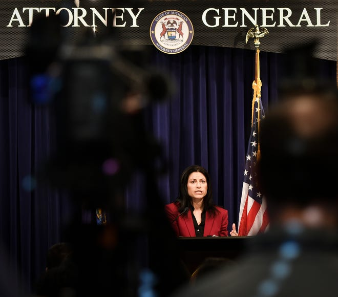 Michigan Attorney General Dana Nessel announces that her office will investigate gymnastics coach John Geddert, Thursday, Feb. 21, 2019, during a press conference at the Frank Kelley Law Library at the AG's office.
