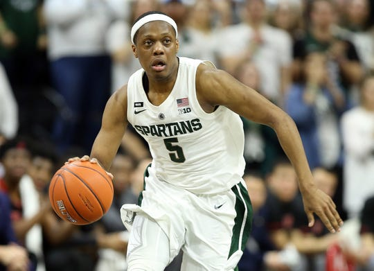 Feb 20, 2019; East Lansing, MI, USA; Michigan State Spartans guard Cassius Winston (5) brings the ball up court during the second half of a game against the Rutgers Scarlet Knights at the Breslin Center. Mandatory Credit: Mike Carter-USA TODAY Sports