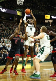 Feb 20, 2019; East Lansing, MI, USA; Michigan State Spartans forward Aaron Henry (11) shoots the ball over Rutgers Scarlet Knights center Shaquille Doorson (2) during the second half at the Breslin Center. Mandatory Credit: Mike Carter-USA TODAY Sports