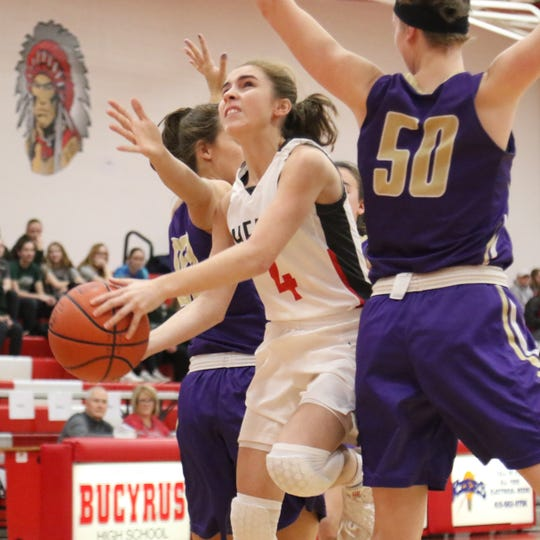 Shelby freshman Sophia Niese scores on a tough layup in the lane in traffic during the Lady Whippets' victory over Vermilion on Wednesday.