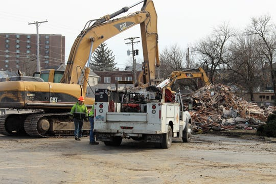 Excavators are parked next to the remains of an old church on Prospect Street, which used to house the First United Church of Christ in Marion. Pastor Gale Green said the decision to move and later demolish the building, which was built in the 1920s, was due to mounting repair costs.