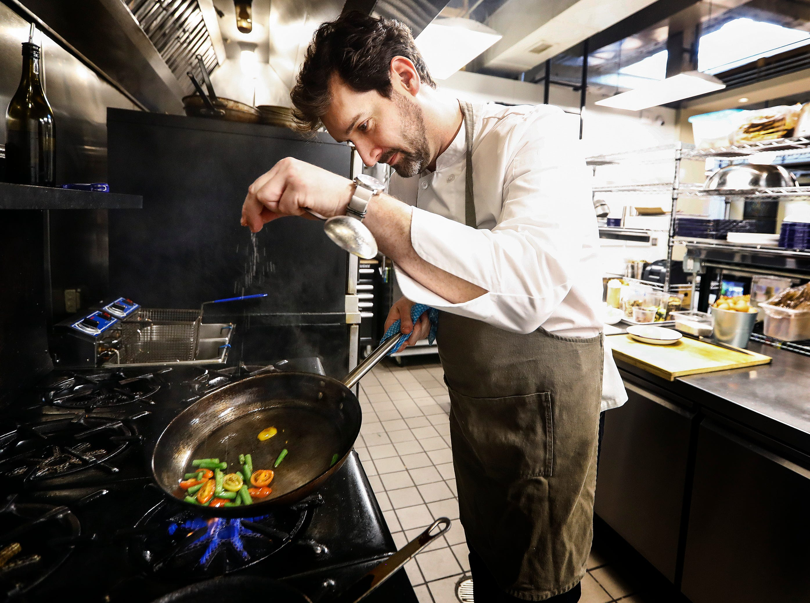 Edge Alley restaurant owner Tim Barker makes the market vegetable pasta dish.
