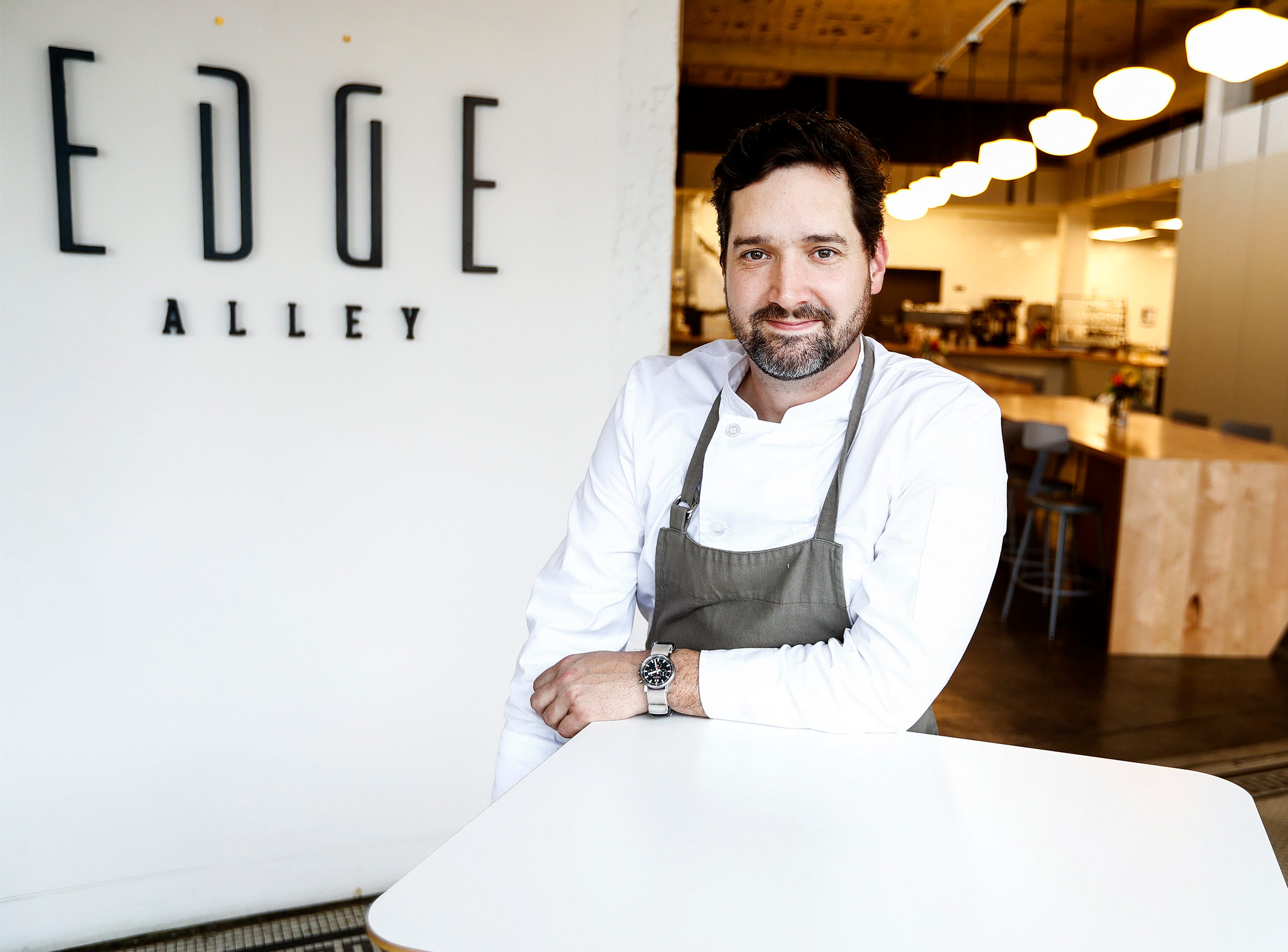 Edge Alley owner Tim Barker opened his concept restaurant that is part coffee shop and art gallery.