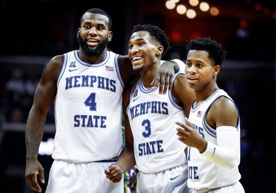 Memphis guard Jeremiah Martin (middle) jokes with his teammates Raynere Thornton (left) and Tyler Harris (right) after scoring 43 points against Tulane at the FedExForum, Wednesday, February 20, 2019.