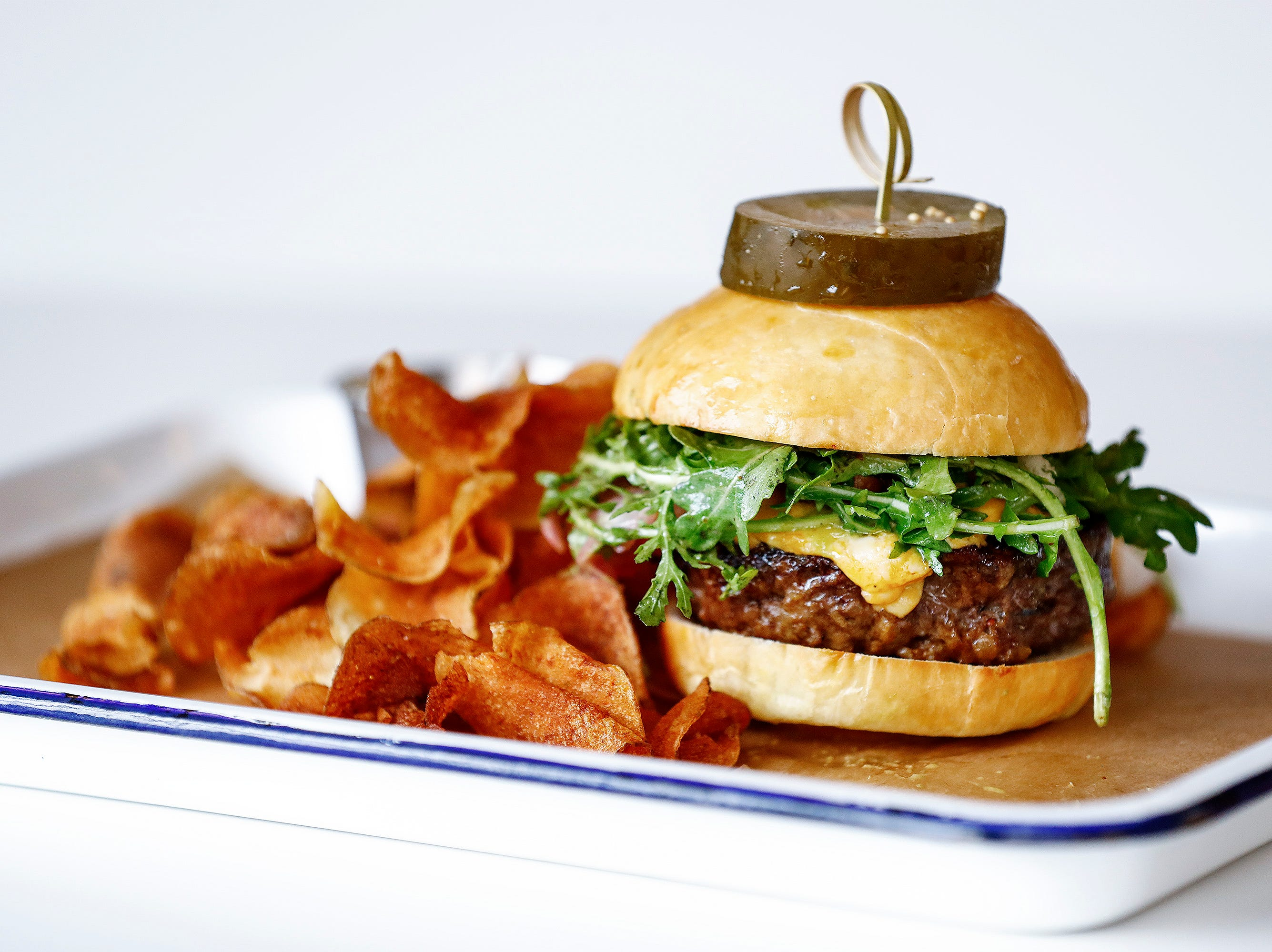 Edge Alley restaurant's burger is locally sourced beef served on a housemaid brioche bun.
