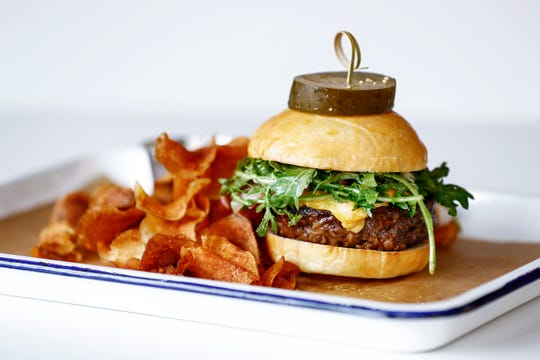 Edge Alley restaurant's burger is locally sourced beef served on a house-made brioche bun.