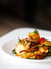 Edge Alley restaurant's market vegetables dish features fresh, local vegetables served with pappardelle pasta and warm red pepper vinaigrette.