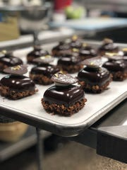 One of the desserts at Milk Bottle Bakery, coming to downtown, is malted vanilla whipped ganache with pecan streusel, verjus cherries and chocolate glaze.