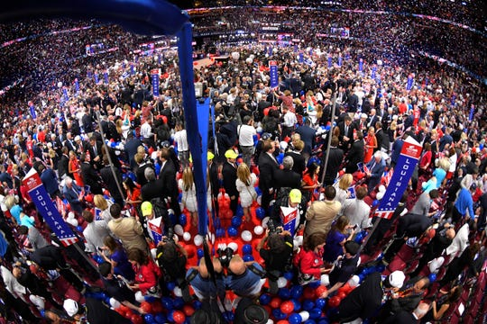Delegates celebrate after Republican Presidential candidate Donald Trump's acceptance speech on the final day of the 2016 Republican National Convention in Cleveland.