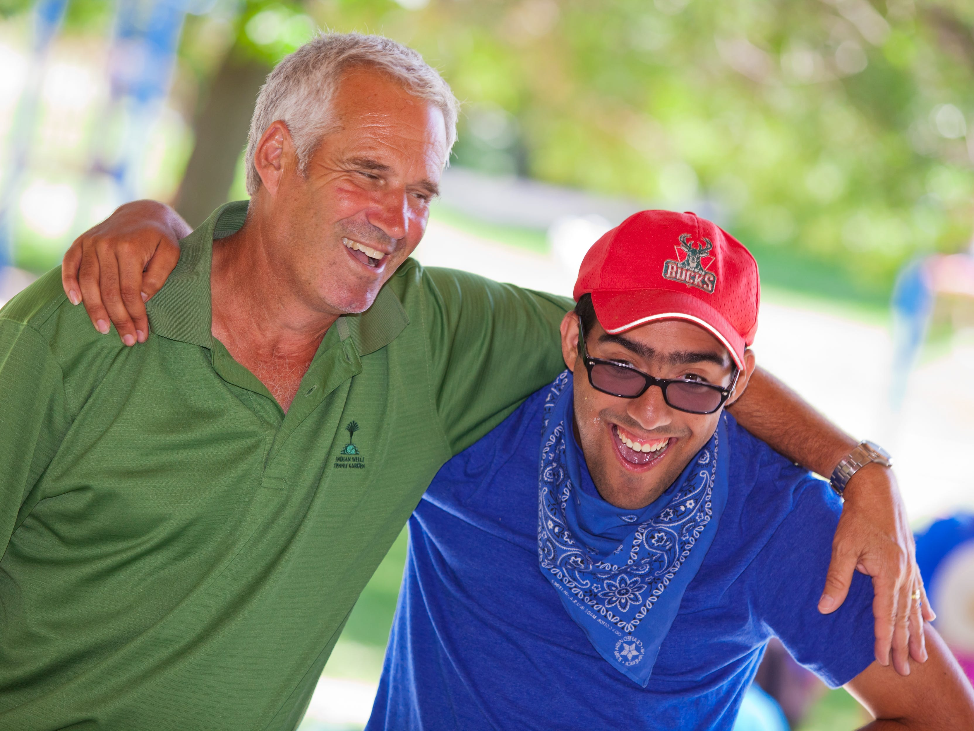 JCC Rainbow Day Camp director Lenny Kass hangs out with camper Michael Torres.